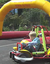 Two children in karts driving round circuit