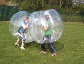 Two youngsters in BodyZorbs battle it out..